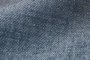 サンペックスイストのシリアル・シャンブレー素材(ショップコート)のアップ